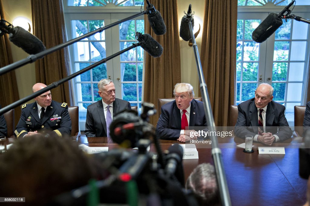 U.S. President Donald Trump, center right, speaks as John Kelly, White House chief of staff, right, and H.R. McMaster, national security advisor, left, and Jim Mattis, U.S. secretary of defense, listen during a briefing with senior military leaders in the Cabinet Room of the White House in Washington, D.C., U.S., on Thursday, Oct. 5, 2017. Mattis said this week the U.S. and allies are holding the line against the Taliban in Afghanistan as forecasts of a significant offensive by the militants remain unfulfilled. Photographer: Andrew Harrer/Bloomberg via Getty Images