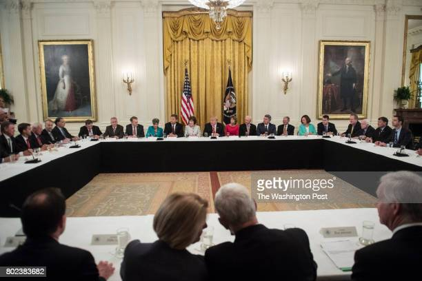 President Donald Trump center speaks as he meets with Republican senators about health care in the East Room of the White House of the White House in...