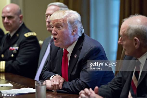 US President Donald Trump center speaks as John Kelly White House chief of staff right listens during a briefing with senior military leaders in the...