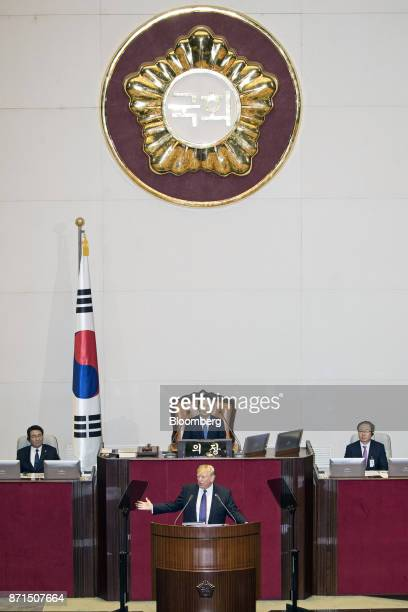 US President Donald Trump center speaks at the National Assembly in Seoul South Korea on Wednesday Nov 8 2017 Trump called on the world to abandon...