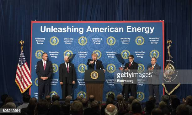 US President Donald Trump center speaks during the Unleashing American Energy event at the Department of Energy in Washington DC US on Thursday June...