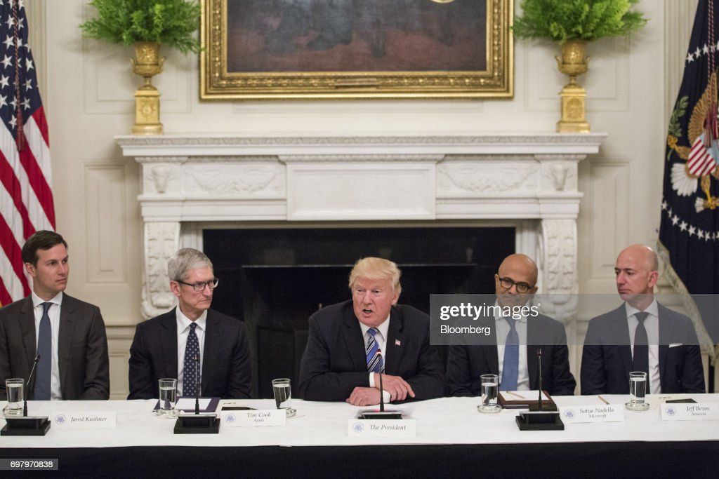U.S. President Donald Trump, center, speaks with tech leaders during the American Technology Council roundtable hosted at the White House in Washington, D.C., U.S., on Monday, June 19, 2017. Executives from many of the world's largest technology companies gathered for the first meeting of the American Technology Council with Trump and his senior advisers. Photographer: Zach Gibson/Bloomberg via Getty Images