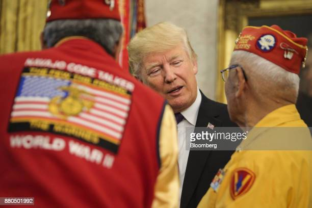 US President Donald Trump center speaks with World War II veterans during an event honoring Native American 'Code Talkers' inside the Oval Officer of...