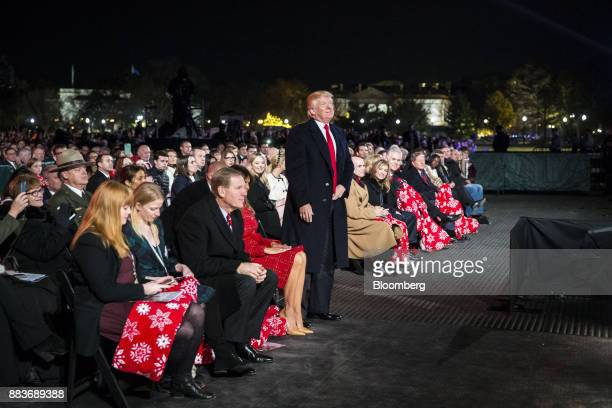 US President Donald Trump center stands during the 95th Annual National Christmas Tree Lighting in Washington DC US on Thursday Nov 30 2017 The White...