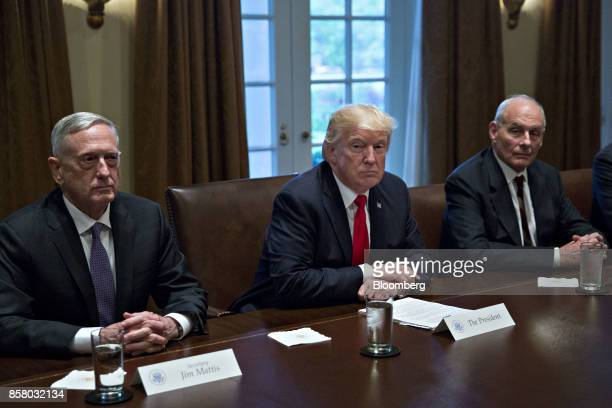 US President Donald Trump center waits to speak while seated next to John Kelly White House chief of staff right and Jim Mattis US secretary of...