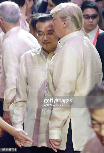 US President Donald Trump chats with Chinese Premier Li Keqiang before the start of the Special Gala Celebration of the 50th Anniversary of ASEAN in...