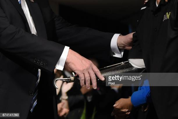 US President Donald Trump checks hands with a veteran at the Department of Veterans Affairs before giving remarks and sign an Executive Order on...