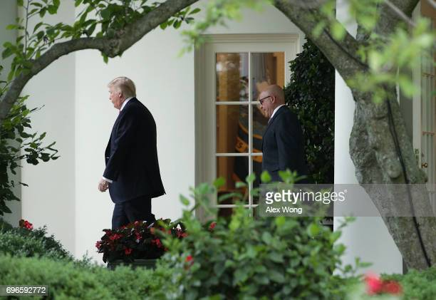 S President Donald Trump comes out from the Oval Office with National Security Adviser HR McMaster prior to a Marine One departure from the White...