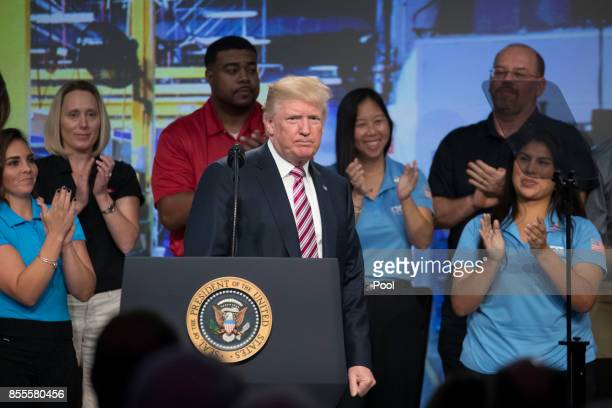 US President Donald Trump concludes his remarks on tax reform to the National Association of Manufacturers at the Mandarin Oriental Hotel September...