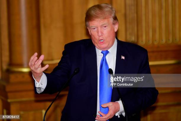 US President Donald Trump delivers a speech at the opening of a welcome dinner hosted by Abe at Akasaka Palace in Tokyo on November 6 2017 Donald...