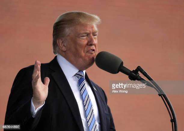 S President Donald Trump delivers keynote address during the commencement at Liberty University May 13 2017 in Lynchburg Virginia President Trump is...