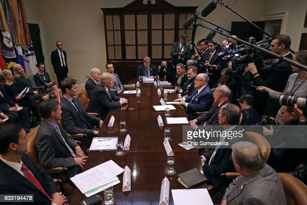 S President Donald Trump delivers remarks at the beginning of a meeting with his staff and government cyber security experts in the Roosevelt Room at...