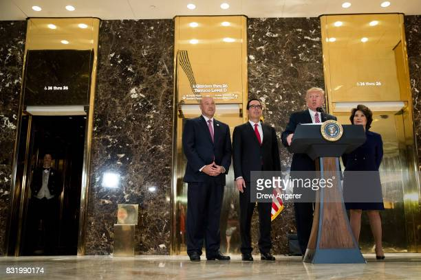 President Donald Trump delivers remarks following a meeting on infrastructure at Trump Tower August 15 2017 in New York City Standing alongside him...