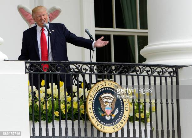 S President Donald Trump delivers remarks from the Truman Balcony to guests on the South Lawn during the 139th White House Easter Egg Roll at The...