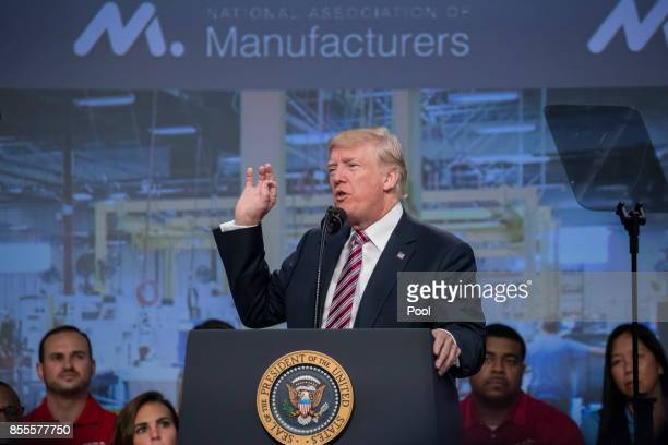 US President Donald Trump delivers remarks on tax reform to the National Association of Manufacturers at the Mandarin Oriental Hotel September 29...