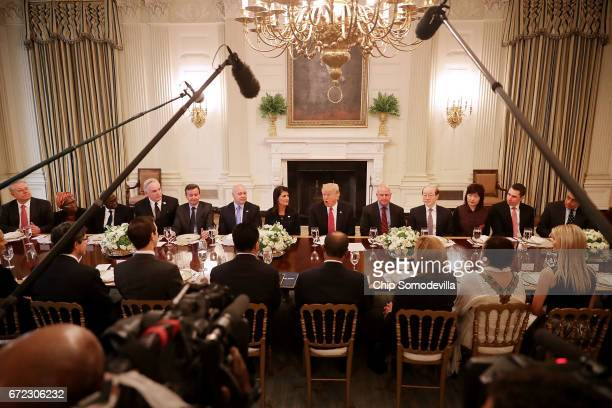 S President Donald Trump delivers remarks while hosting ambassadors from the 15 country members of the United Nations Security Council flanked by his...