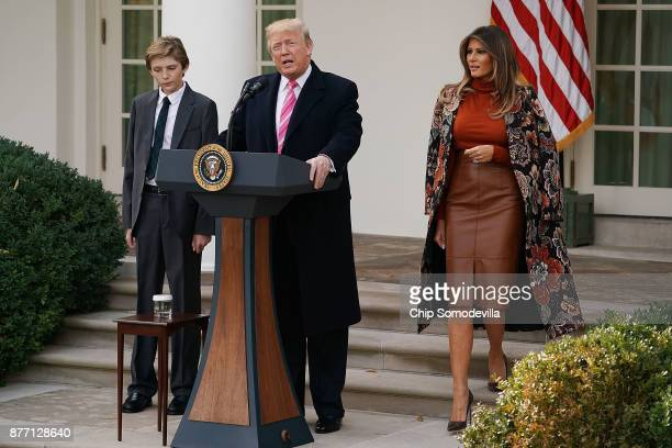 S President Donald Trump delivers remarks with his son Barron Trump and first lady Melania Trump before pardoning the National Thanksgiving Turkey in...