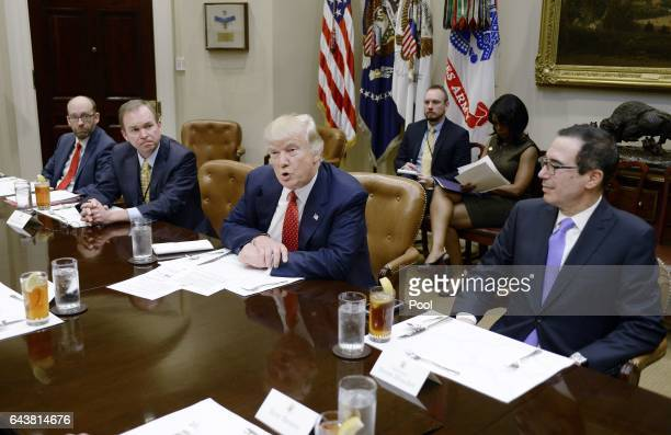 US President Donald Trump discusses the federal budget as Treasury Secretary Steve Mnuchin looks on in the Roosevelt Room of the White House on...
