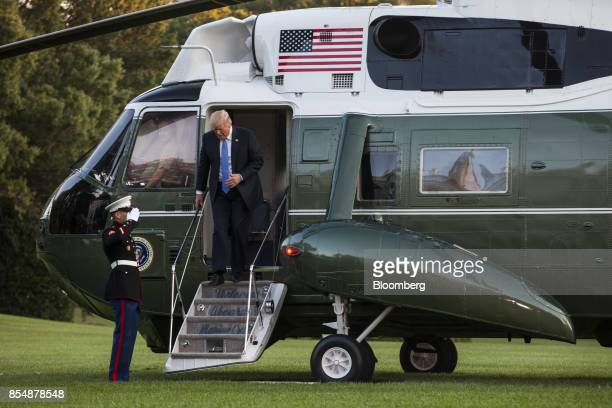 US President Donald Trump disembarks Marine One after returning to the White House in Washington DC US on Sept 27 2017 Trump called the tax reform...
