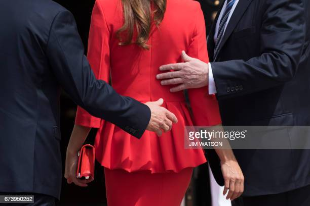 US President Donald Trump escorts Argentinian President Mauricio Macri and his wife Juliana Awada at White House in Washington DC April 27 2017 / AFP...