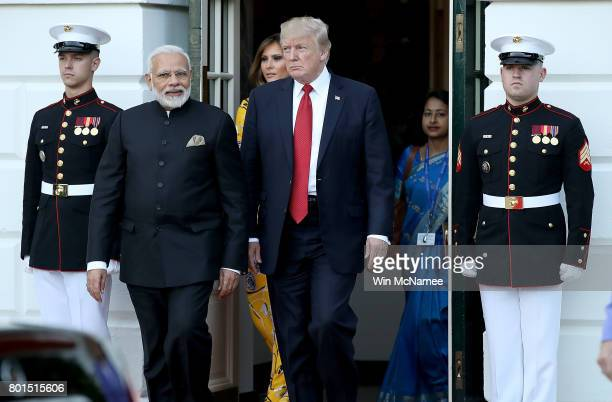 S President Donald Trump escorts Indian Prime Minister Narendra Modi as Modi departs the White House June 26 2017 in Washington DC Trump and Modi had...