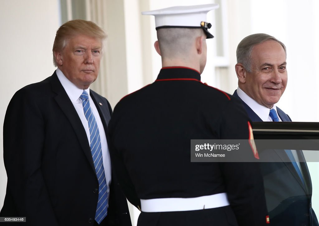 U.S. President Donald Trump (L) escorts Israel Prime Minister Benjamin Netanyahu (R) to his waiting vehicle following meetings at the White House February 15, 2017 in Washington, DC. President Trump hosted Prime Minister Netanyahu for talks for the first time since Trump took office on January 20.