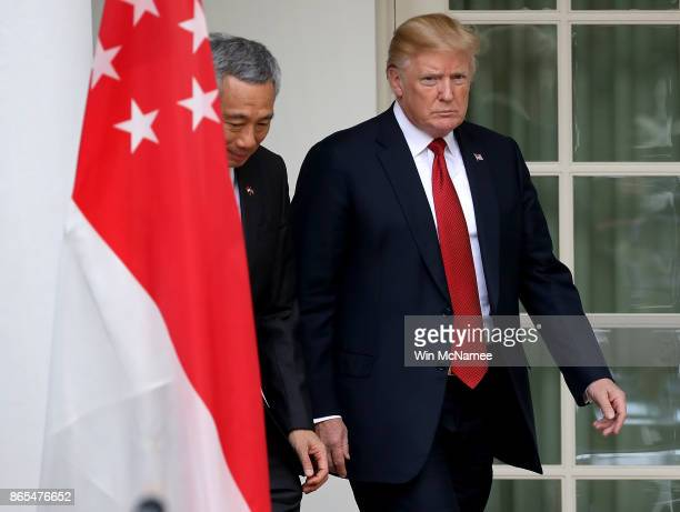 S President Donald Trump escorts Singapore Prime Minister Lee Hsien Loong before the two leaders delivered joint statements in the Rose Garden of the...