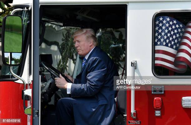 President Donald Trump examines a fire truck from Wisconsinbased manufacturer Pierce during a 'Made in America' product showcase event on the South...