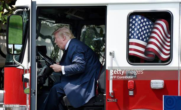 President Donald Trump examines a fire truck from Wisconsinbased manufacturer Pierce on the South Lawn during a 'Made in America' product showcase...