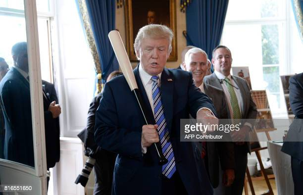 US President Donald Trump examines USmade products from all 50 states including a Marucci baseball bat in the Blue Room of the White House during a...