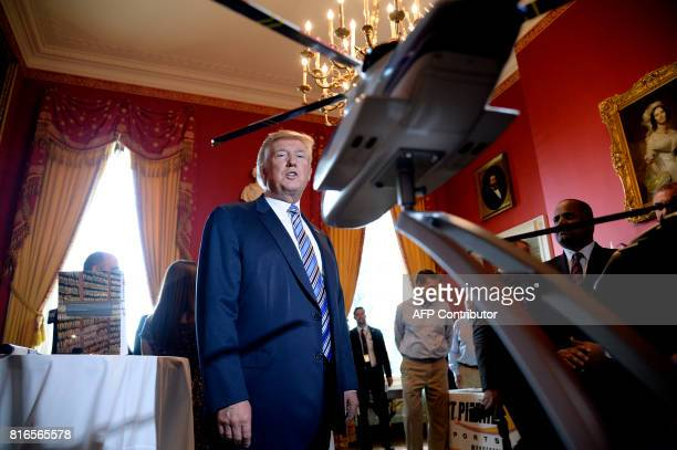 US President Donald Trump examines USmade products from all 50 states including helicopter models from Sikorsky in the Red Room of the White House...