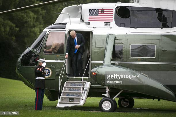 US President Donald Trump exits Marine One on the South Lawn of the White House in Washington DC US on Friday Oct 13 2017 States regulators...