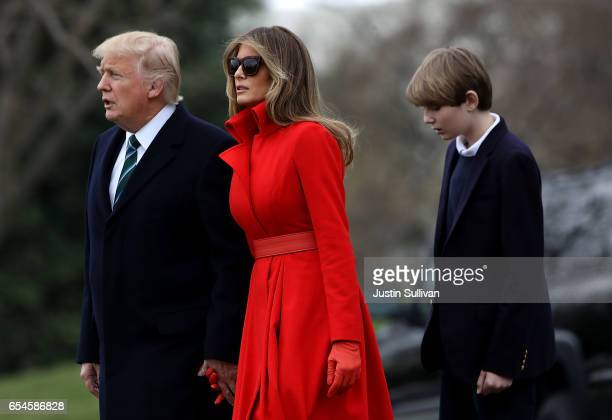 US President Donald Trump First Lady Melania Trump and son Barron Trump prepare to depart the White House on March 17 2017 in Washington DC President...
