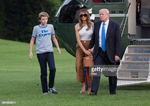 US President Donald Trump first lady Melania Trump and their son Barron Trump arrive at the White House June 11 2017 in Washington DC According to...