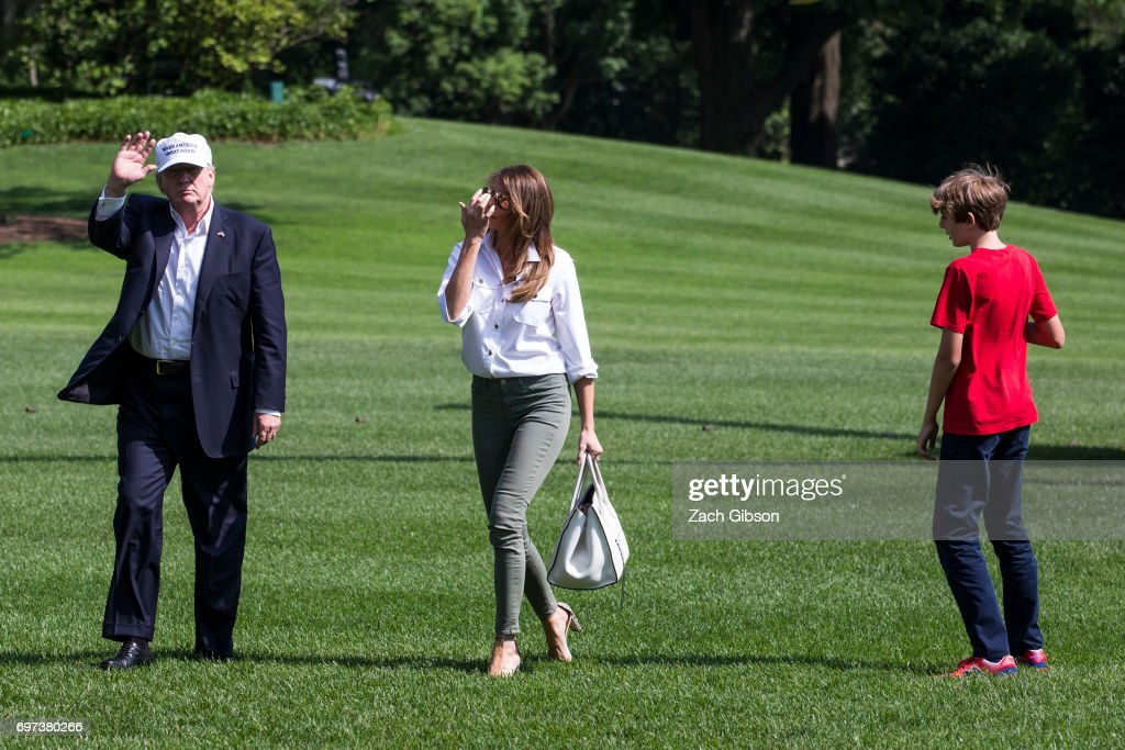 President Donald Trump, First Lady Melania Trump and their son, Barron Trump, cross the South Lawn after arriving at The White House on June 18, 2017 in Washington, D.C. President Trump spent the weekend at Camp David.