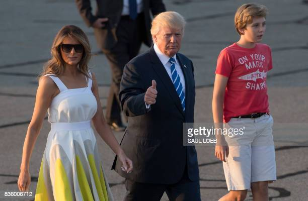 US President Donald Trump First Lady Melania Trump and their son Barron walk to board Air Force One prior to departure from Morristown Municipal...