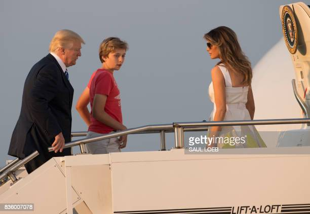 US President Donald Trump First Lady Melania Trump and their son Barron board Air Force One prior to departure from Morristown Municipal Airport in...