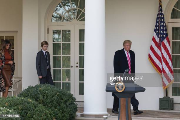 President Donald Trump First Lady Melania Trump and their son Barron leave the Oval Office for the National Thanksgiving Turkey Pardoning Ceremony in...