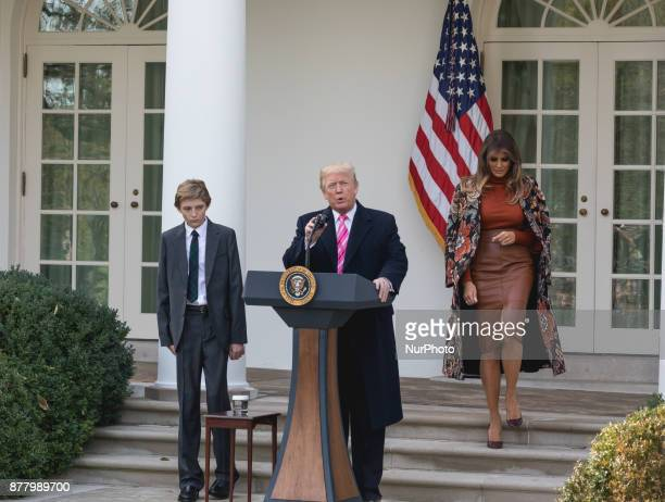 President Donald Trump First Lady Melania Trump and their son Barron walk to the Rose Garden for the National Thanksgiving Turkey Pardoning Ceremony...