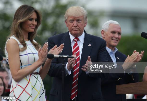 S President Donald Trump first lady Melania Trump and Vice President Mike Pence applaud during a Congressional Picnic on the South Lawn of the White...