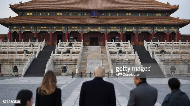 TOPSHOT US President Donald Trump First Lady Melania Trump China's President Xi Jinping and his wife Peng Liyuan look at the Forbidden City in...