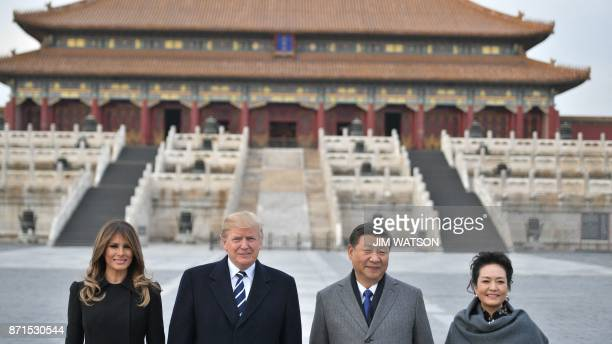 TOPSHOT US President Donald Trump First Lady Melania Trump China's President Xi Jinping and his wife Peng Liyuan pose in the Forbidden City in...