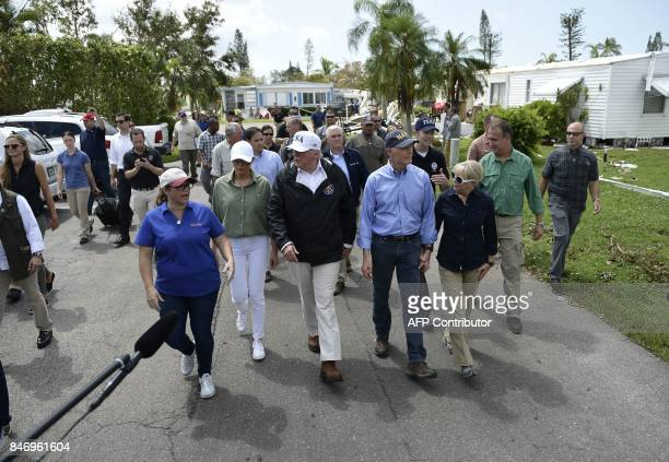 US President Donald Trump First Lady Melania Trump Florida Governor Rick Scott and his wife Ann Scott tour a neighborhood affected by Hurricane Irma...