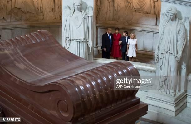 US President Donald Trump First lady Melania Trump French President Emmanuel Macron and his wife Brigitte Macron visit Napoleon Bonapartes tomb at...