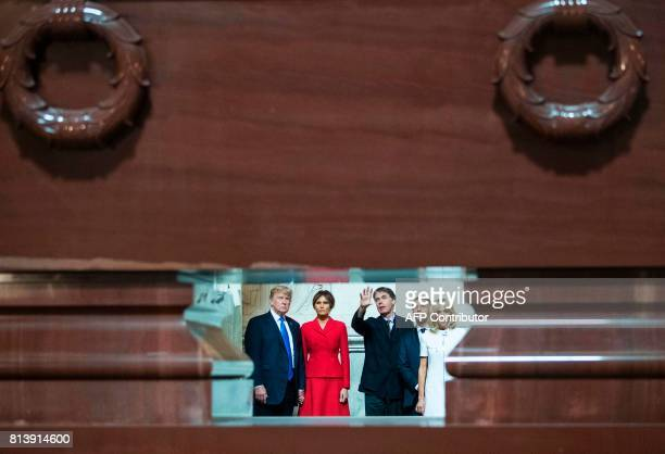 US President Donald Trump First Lady Melania Trump French President Emmanuel Macron and his wife Brigitte Macron listen to the Director of the Army...