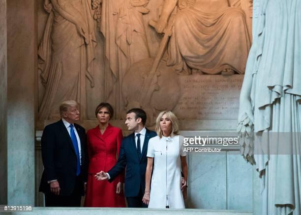 US President Donald Trump First lady Melania Trump French President Emmanuel Macron and his wife Brigitte Macron visit Napoleon Bonaparte's tomb at...