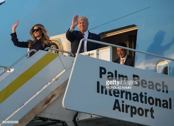 US President Donald Trump First Lady Melania Trump Japanese Prime Minister Shinzo Abe walk off Air Force One at Palm Beach International Airport in...