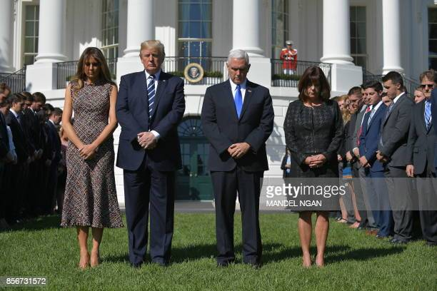 US President Donald Trump First Lady Melania Trump Vice President Mike Pence wife Karen Pence and White House staff take part in a moment of silence...