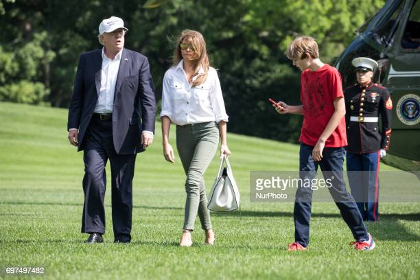 President Donald Trump First Lady Melanie Trump and their 11yearold son Barron arrived on Marine One on the South Lawn of the White House on Fathers...