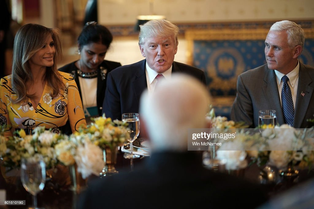U.S. President Donald Trump (C), flanked by first lady Melania Trump (L) and Vice President Mike Pence (R), delivers remarks before dinner with Indian Prime Minister Narendra Modi (C) at the White House June 26, 2017 in Washington, DC. Trump and Modi met earlier today in the Oval Office to discuss a range of bilateral issues.